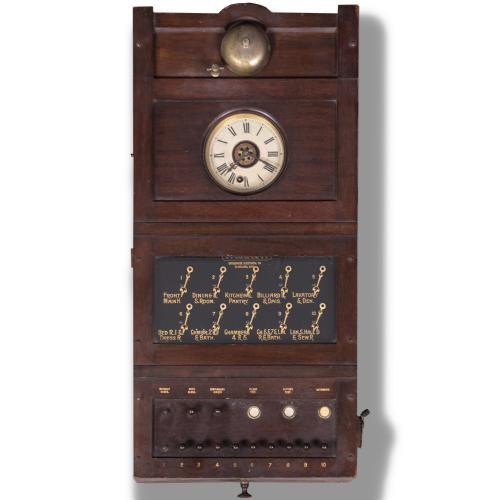 An Antique Oak Servant Annunciator with Bell by Partrick, Carter and Wilkins, c. 1889,