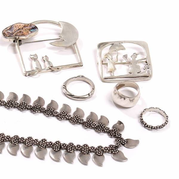 Georg Jensen m.fl.: A sterling silver necklace, two brooches and three rings, one brooch set with abelone shell. Ring size 49.5-59. (6)