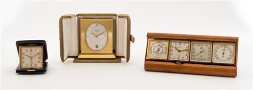 * Three Travel Alarm Clocks Width of widest 6 1/4 inches.