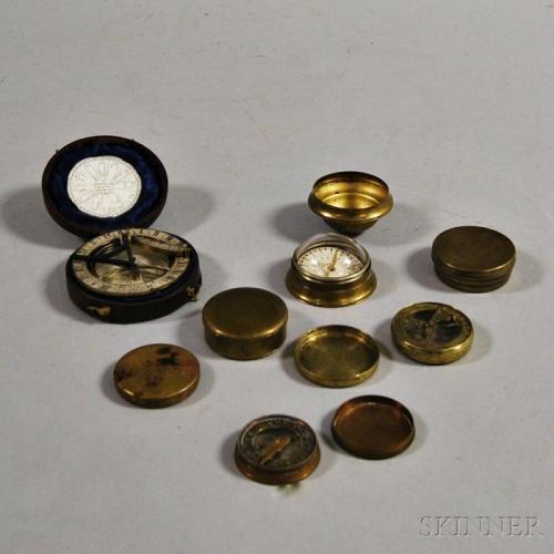 Seven Small Brass Compasses