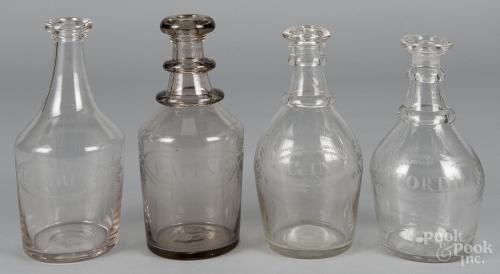 Four etched flint glass liquor bottles, inscribed Gin, Cordial, J. Spirits, and P. Wine