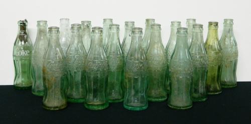 18 Coca Cola bottles