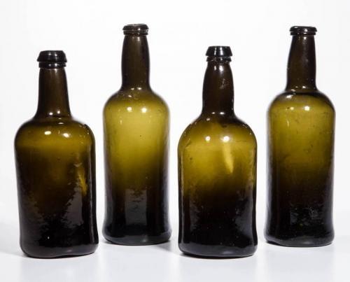 ENGLISH BLACK GLASS WINE / SPIRITS BOTTLES, LOT OF FOUR