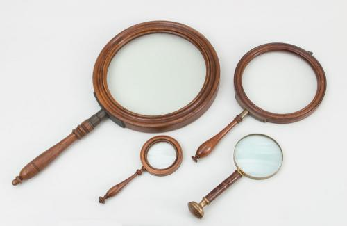 FOUR MAGNIFYING GLASSES