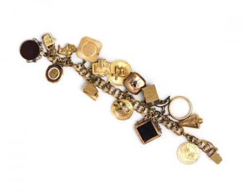A 14 Karat Yellow Gold Bracelet with Fifteen Attached Charms, 44.40 dwts.