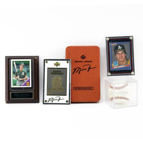 Vintage Sports Memorabilia Including a Mickey Mantle Signed Baseball, Mark McQwire Baseball card, Jose Canseco Baseball card and Michael Jordan