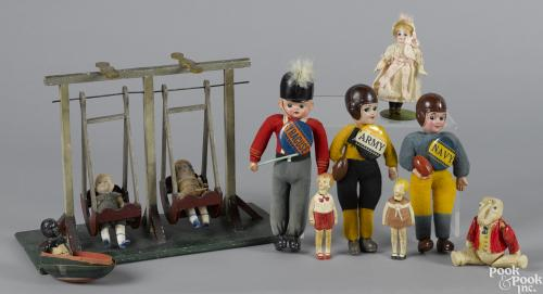 Celluloid figures and toys, to include three dressed souvenir celluloid football dolls