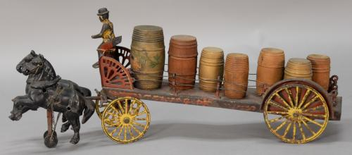 Wilkins cast iron and pressed steel horse drawn dray wagon having seven wooden barrels, one with label NULLGold MedalNULL, driver in derby...