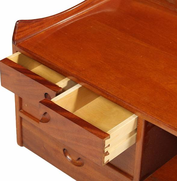 Danish cabinetmaker: A wall mounted mahogany dressing table, front with five drawers with integrated handles. 1940-1950's. H. 42. W. 100. D. 40 cm.