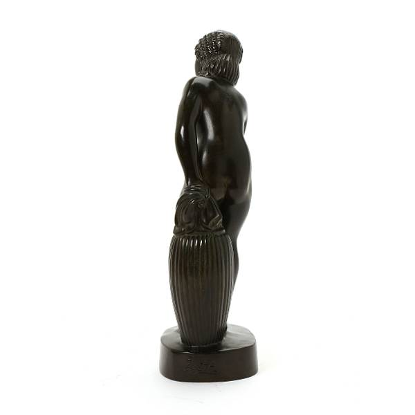 Just Andersen: Young woman bending. Signed Just A. Figure of patinated discometal. H 27 cm.