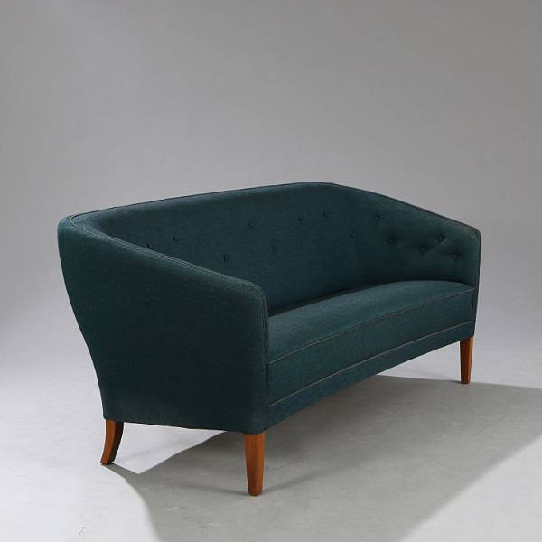 Ludvig Pontoppidan: Freestanding three seater sofa with stained beech legs. Seat, sides and back upholstered with turquoise blue wool.