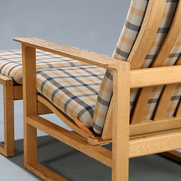 "Børge Mogensen: ""The Runner Chair"". Highback oak easy chair with matching stool. Manufactured by Fredericia Furniture. (2)"