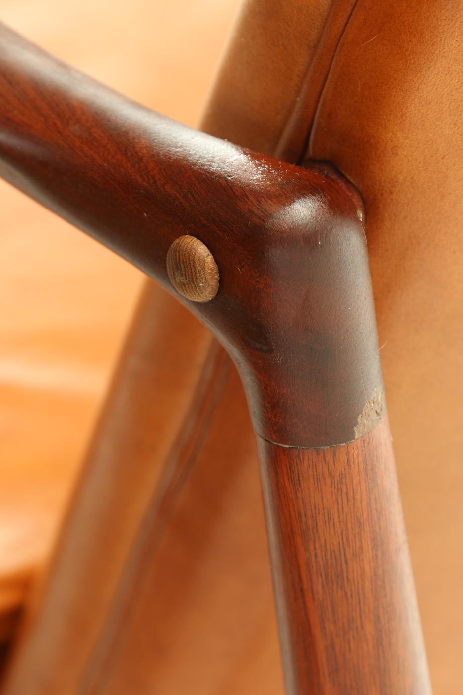 Finn Juhl. 'Kaminstolen', a few armchairs, teak and leather, Bovirke (2)