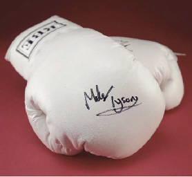 A pair of white leather BBE boxing gloves