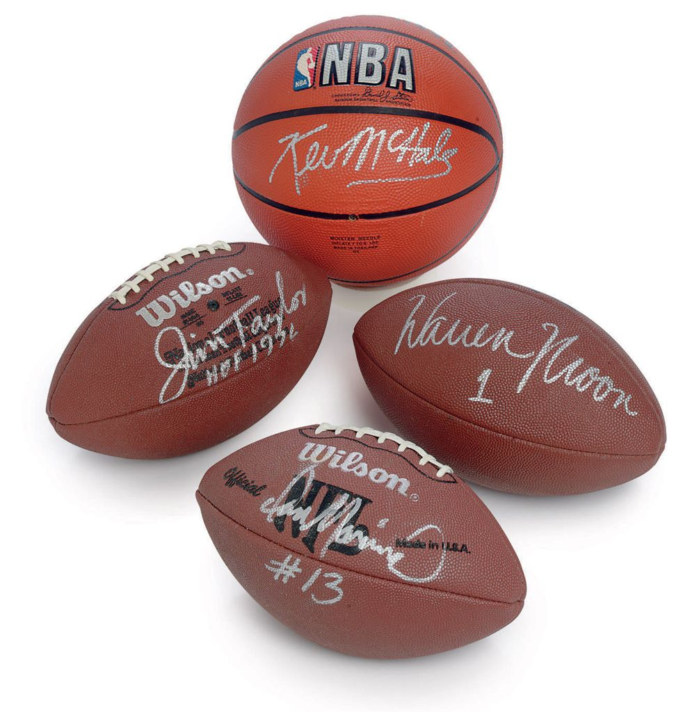 A GROUP OF FOUR AUTOGRAPHED SPORTS MEMORABILIA