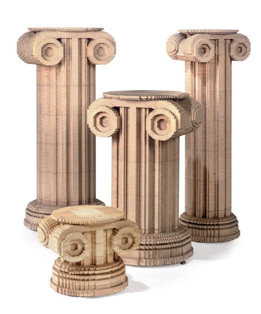 A SET OF THREE FLUTED 'LEGO' COLUMNS