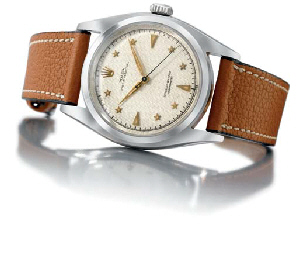 Rolex. A very fine, rare and large stainless steel self-winding water-resistant bubble back wristwatch with sweep centre seconds, honeycomb dial and star numerals