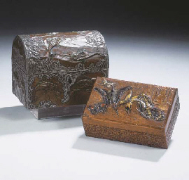 Two hammered copper and wooden caskets