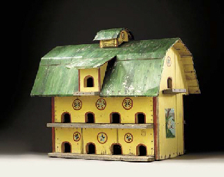 A PAINTED WOOD AND TIN BIRD HOUSE
