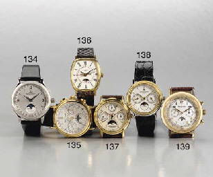LONGINES. AN 18K GOLD TRIPLE CALENDAR MOONPHASE WRISTWATCH WITH CHRONOGRAPH