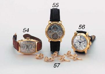 Audemars Piguet. A fine 18K self-winding skeletonized tourbillon backwound wristwatch with power reserve indicator and date