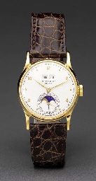 Patek Philippe. A fine and rare 18K gold perpetual calendar wristwatch with phases of the moon