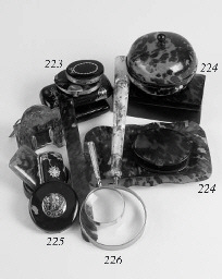 Four various magnifying glasses