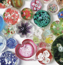FIFTY-SEVEN PAPERWEIGHT AND PAPERWEIGHT RELATED OBJECTS,