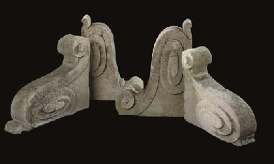 A GROUP OF FOUR PORTLAND STONE CORBELS