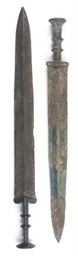 TWO CHINESE BRONZE SWORDS,