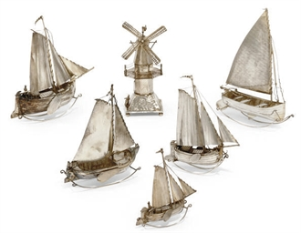 A GROUP OF DUTCH SILVER TOY SAILING SHIPS