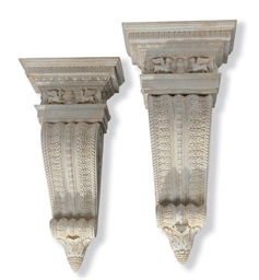 A PAIR OF CARVED AND PAINTED HARDWOOD CORBELS