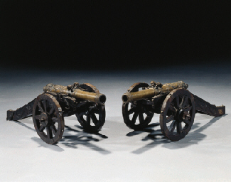 A pair of Dutch bronze miniature cannons