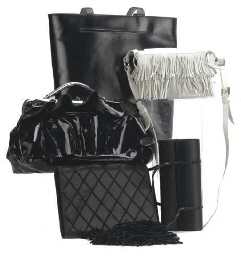 A LARGE COLLECTION OF HANDBAGS AND WALLETS