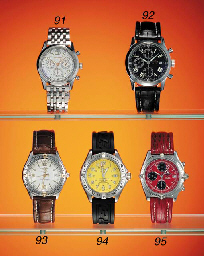 Breitling. A stainless steel limited edition self-winding tonneau-shaped waterproof chronograph wristwatch with date