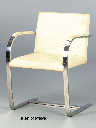 A SET OF TWELVE CHROMED FLAT STEEL AND CREAM UPHOLSTERED 'BRNO' DINING CHAIRS,