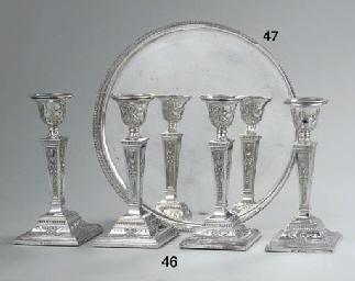 Four English silver candlesticks