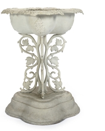 A WHITE-PAINTED CAST-IRON BIRDBATH,