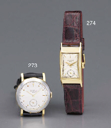 Patek Philippe. An 18K gold curved rectangular-shaped wristwatch with two-tone dial