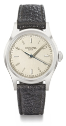 Patek Philippe. A fine and rare stainless steel wristwatch with sweep centre seconds and unusual dial layout