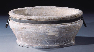 A white-veined red and grey marble wine cooler
