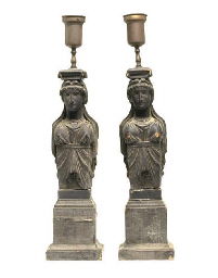 A PAIR OF CARVED OAK CORBELS MOUNTED AS LAMPS,