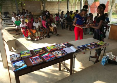 Closing the Summer Giving Books and Pens to the Community