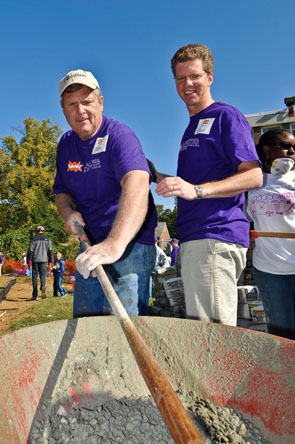 Secretary Tom Vilsack mixes concrete