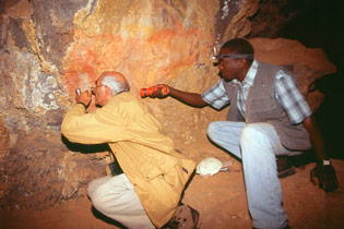 Jean Clottes and George Abungu investigating rock art in Suswa cave, Mt Suswa, Rift Valley, Kenya.