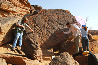 David Coulson with laser scanning specialists scanning a life-size elephant engraving in southern Libya.