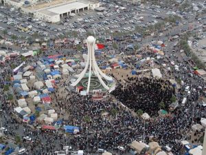 Bahrain protestors gather in the Pearl Roundabout before it was demolished. (Wikimedia Commons)