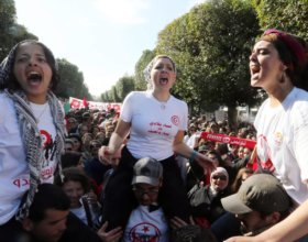 Women shout slogans during a demonstration in Tunis against the Islamist-led government, in 2012.  (@Mohamed MessarEPA, via Landov)