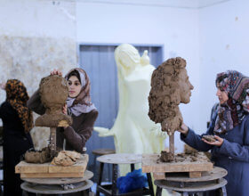 Palestinian students at Al-Aqsa University work on clay sculpture (Photo by NurPhoto via Getty Images).