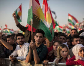 People at a rally this month for an independent Kurdistan, in Erbil (Photo: Oliver Weiken, AP)